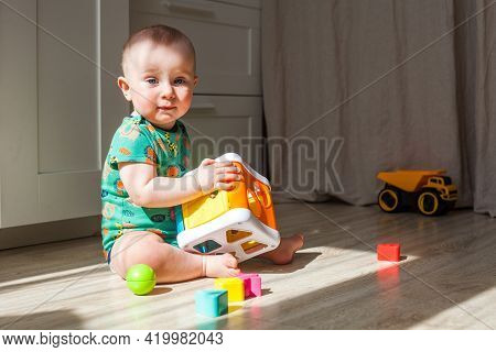 Eight-nine Month Baby Boy Plays On The Floor
