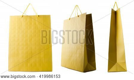 Yellow Paper Bag Isolated On White Background. Side, Front, Three-quarter View.