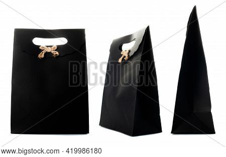 Black Paper Bag Isolated On White Background. Side, Front, Three-quarter View.