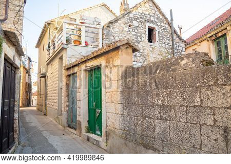 Buildings In Milna On Brac Island, Street Without Tourists, Dalmatia, Croatia