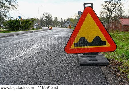 Road Sign With Warning Of Bumpy Road