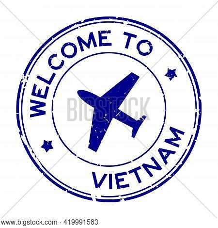 Grunge Blue Welcome To Vietnam Word With Airplane Icon Round Rubber Seal Stamp On White Background