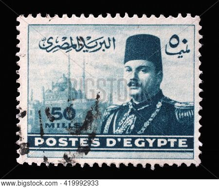 ZAGREB, CROATIA - SEPTEMBER 18, 2014: Stamp printed in Egypt shows King Farouk in front of Cairo Citadel, circa 1947