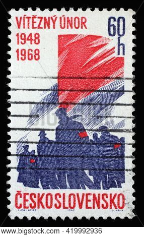 ZAGREB, CROATIA - SEPTEMBER 18, 2014: Stamp printed in Czechoslovakia shows crowd of workers and banner or flag, 20th anniversary of victorious February revolution, circa 1968