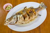 Seep Fried sea bass with fish sauce serve with seafood sauce poster
