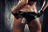 sexy woman with hand gun poster
