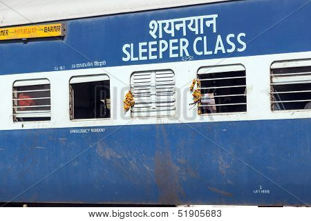 Passengers Hanging At The Window Of A Moving Indian Railway  Train