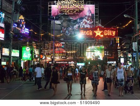 Patong, Thailand - April 26, 2012: People Walk In The Evening On Bangla Road