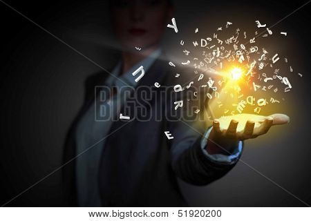 Image of businessperson holding characters on palm