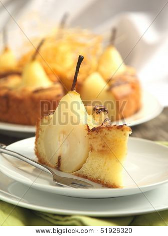 Piece Of Cake With Pears With Spun Sugar Strands.