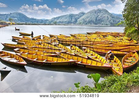POKHARA, NEPAL - MAY 22, 2013: An unidentified Nepalese fishing at Phewa lake in Pokhara , Nepal on May 22, 2013. One of the most beautiful Lakes of Pokhara Valley is the well-known Phewa Lake.