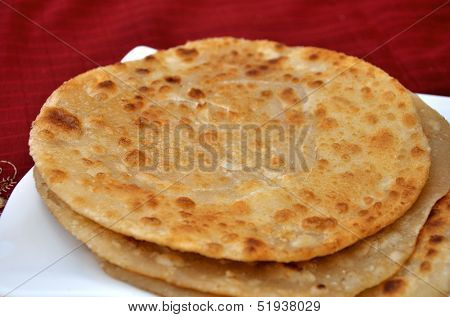 A traditional and hot Pakistani and Indian bread poster
