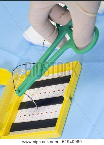 Suture Needle Resting On  Needle Holder
