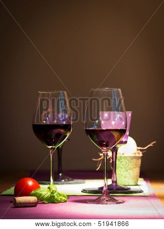 two redwine glasses with tomato and basil