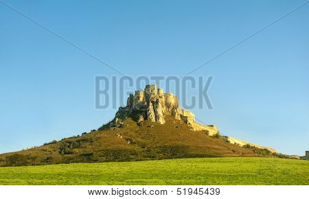 Ancient Slovak castle Spissky hrad lit by the setting sun