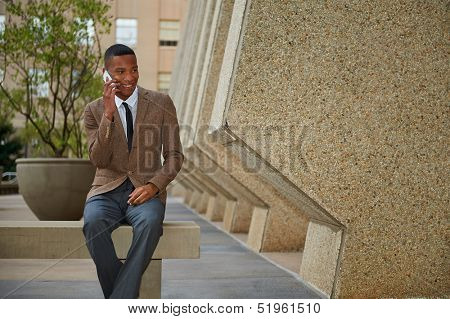 Young relaxed successful African - American business man in the city