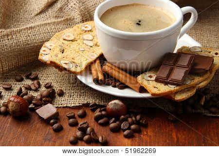 Cup of tasty coffee with tasty Italian biscuits, on wooden background
