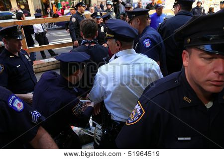 Arresting another marcher on Broadway