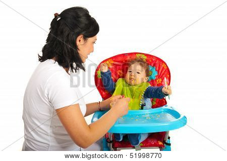 Mother Feedin Baby With Puree