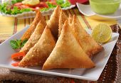 Fresh, delicious hot and spicy beef samosa with rita poster