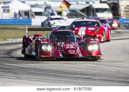 Sebring, FL - Mar 13, 2014:  The Speedsource Mazda takes to the track on Continental tires for a practice session for the 12 Hours of Sebring at Sebring International Raceway in Sebring, FL.