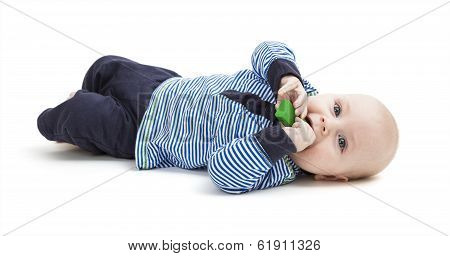 Toddler With Toy On Floor