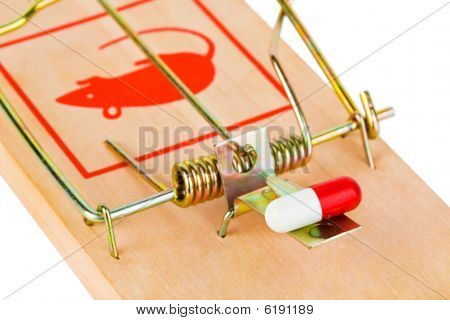 Mousetrap and pill isolated on white background poster