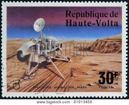 UPPER VOLTA - CIRCA 1976: A stamp printed in Upper Volta dedicated to Operation Viking Sur Mars