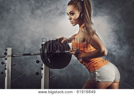 Young  attractive woman exercising in a gym