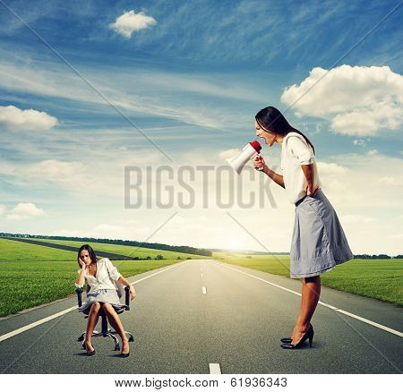 angry emotional woman and lazy woman on the road