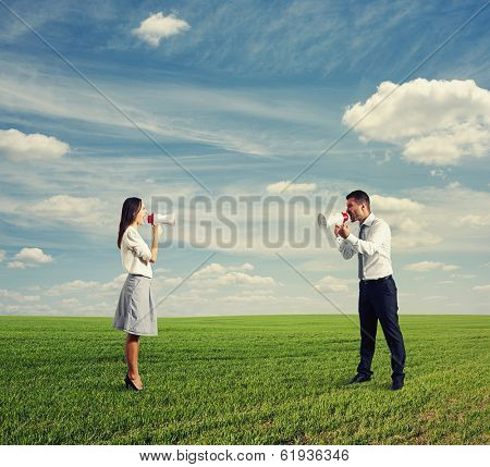 angry emotional female and emotional male on the field