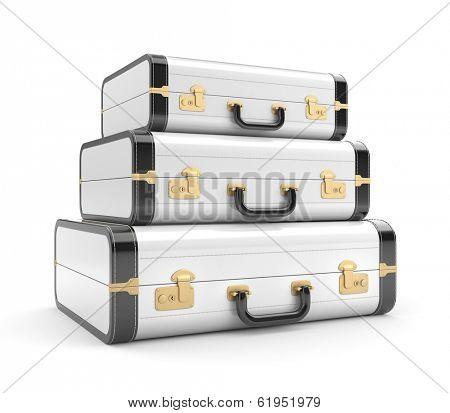 Three white vintage suitcase