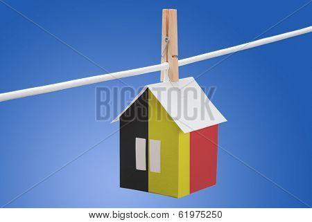 Belgian flag on paper house