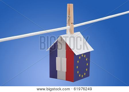 France and European Union flag on paper house