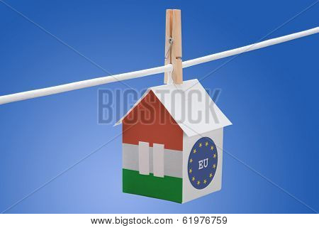 Hungary, Hungarian and EU  flag on paper house
