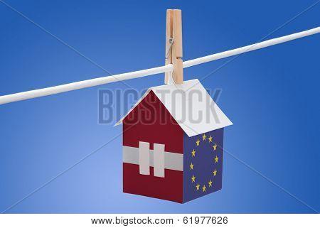 Latvia, Latvian and EU flag on paper house