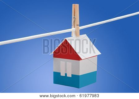 Luxembourg flag on paper house