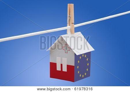 Malta, Maltese and EU flag on paper house