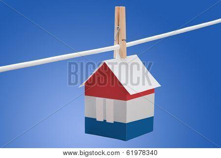 Netherlands, dutch flag on paper house