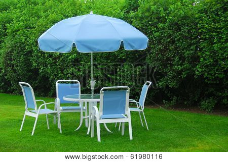 Patio furniture on green lawn