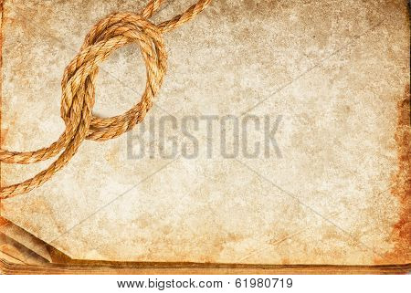 Grunge Texture Of Old Book Paper Sheet And Hemp Rope With Space For Your Text