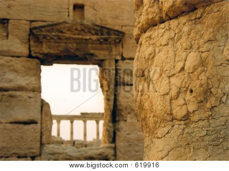 flaking mud columns in the roman city of palmyra in the barren syrian desert poster