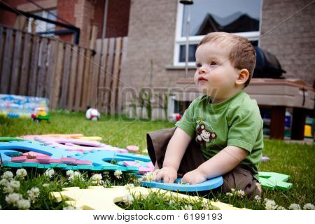Child Playing With His Toys