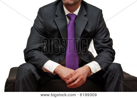 Man In Suit Wearing Purple Tie, Isolated On White
