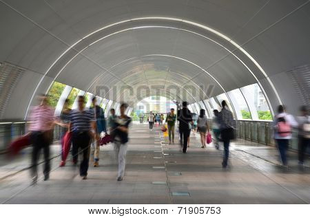 Dynamic photo of busy crowd of people walking, blurred motion.