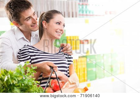 Happy Young Couple At Supermarket
