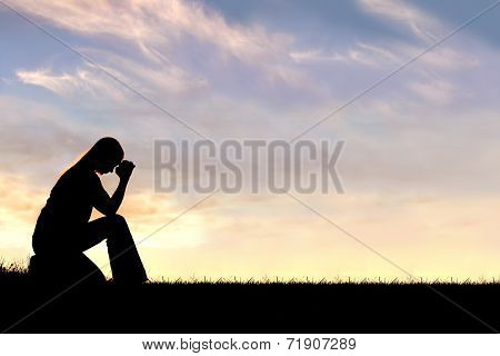 Woman Sitting Down In Prayer Silhouette