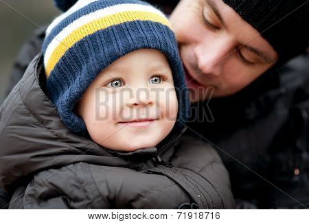 Father and sonin winter