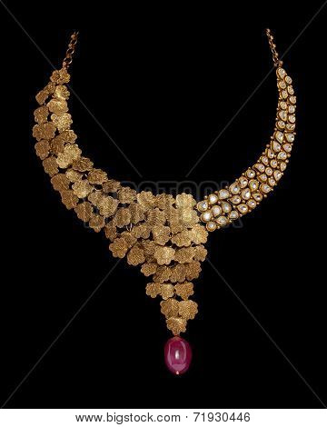 Close up of gold and diamond necklace