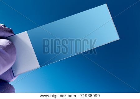 Empty Microscopy slide in hand